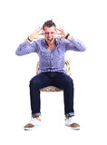 Young caucasian handsome man sitting on the chair isolated Stock Photography