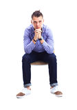 Young caucasian handsome man sitting on the chair isolated Stock Photo