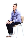 Young caucasian handsome man sitting on the chair Stock Photos