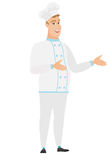 Young caucasian happy chef cook gesturing. Caucasian chef cook in uniform gesturing. Full length of cheerful chef cook gesturing with his hands. Chef cook Royalty Free Stock Photos
