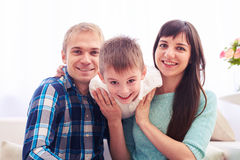 Young Caucasian happy family in their living room have fun while Stock Image