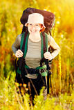 Young caucasian hiking woman with backpack happily smiling Stock Images