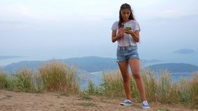 Young Caucasian Hipster Girl Taking Selfie on Mobile Phone. Phuket, Thailand. HD Slowmotion. stock footage