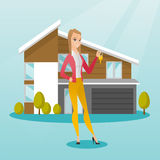 Young caucasian homeowner with key. Royalty Free Stock Photo