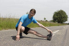Young caucasian jogger stretching Royalty Free Stock Photography