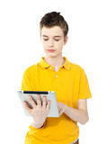 Young caucasian kid working on tablet pc Stock Photo
