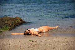 Young Caucasian lady relaxing on the beach Royalty Free Stock Photos