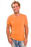Young caucasian male in a bright orange t-shirt and jeans Royalty Free Stock Image