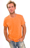 Young caucasian male in a bright orange t-shirt and jeans Stock Photo