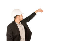 Young Caucasian Male Engineer Showing Something Royalty Free Stock Image
