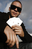 Young caucasian man with ace cards. Young caucasian man playing cards outside Royalty Free Stock Photos