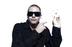 Young caucasian man with ace cards. Young caucasian man playing cards, white background isolated Stock Images