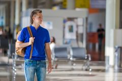 Young caucasian man at airport indoor waiting for Royalty Free Stock Images
