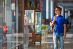 Young caucasian man at airport indoor waiting for Royalty Free Stock Photo