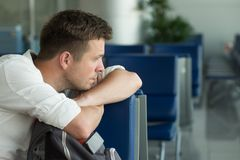 Young caucasian man at the airport waiting for his plane Royalty Free Stock Photography