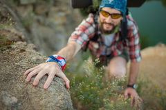 Young caucasian man with backpack climbing the Stock Photo