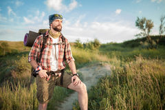 Young caucasian man with backpack walking on the Stock Photo