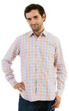 Young caucasian man with beard. Portrait of a young caucasian man with a hand on hips Stock Photography