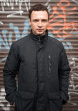 Young Caucasian man in black jacket Stock Photo