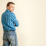 Young Caucasian man in blue shirt and jeans Stock Photos
