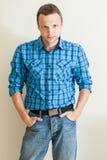 Young Caucasian man in blue shirt Stock Photo