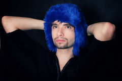 Young Caucasian man in a blue winter hat Stock Photo