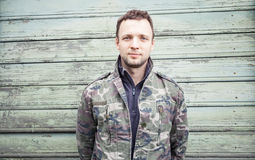 Young Caucasian man in camouflage uniform Royalty Free Stock Image