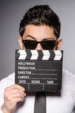 The young caucasian man with clapperboard against Stock Images