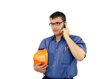 Young caucasian man with construction helmet speaks on the phone Stock Image