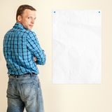 Young Caucasian man with empty white paper Stock Photos