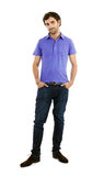 Young caucasian man, full length. Full length portrait of a caucasian young man with hands in his pockets Stock Images