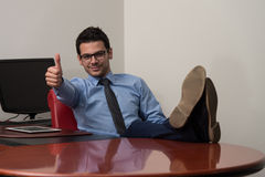 Young Caucasian Man With Glasses Showing Thumbs Up Stock Image