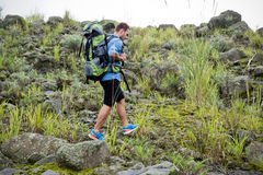 Young caucasian man go trekking on a roccky hill Stock Images