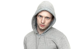 Young Caucasian man in gray jacket with hood. Portrait isolated Stock Photography