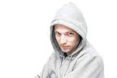 Young Caucasian man in gray jacket with hood Stock Photo