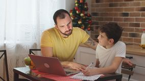 Young father helper and studying kid boy at home