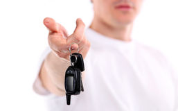 Young caucasian man holding car key Royalty Free Stock Photos