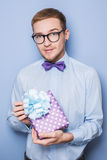 Young caucasian man holding colorful gift. Present, birthday, Valentine Royalty Free Stock Photography
