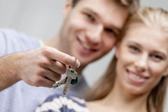 Young caucasian man holding keys Royalty Free Stock Images
