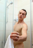 Young Caucasian man holding a towel Stock Image
