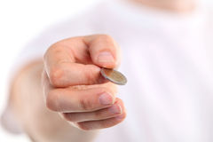 Young caucasian man holding a two euro coin Royalty Free Stock Image