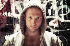 Young Caucasian man in hood, street artist portrait Royalty Free Stock Photo