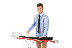 Young caucasian man ironing Royalty Free Stock Images