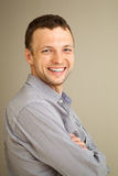 Young Caucasian man laughs, casual portrait Stock Photos