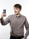 Young caucasian man making selfie photo Stock Images