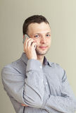 Young Caucasian Man with mobile phone Royalty Free Stock Photography
