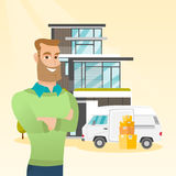 Young caucasian man moving to a house. Royalty Free Stock Photo