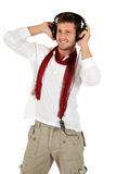 Young caucasian man, music listening Royalty Free Stock Photo