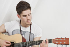 Young Caucasian man playing guitar Royalty Free Stock Photography