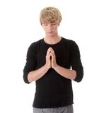 Young caucasian man praying Royalty Free Stock Photography